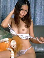 Petite asian opens her tight virgin pussy